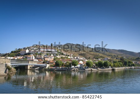 View from the Douro river to Pinhão vilage in Portugal - stock photo