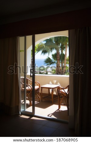 view from the hotel window at the sea and palm trees - stock photo