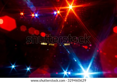 View from the illuminated empty concert stage to the dark auditorium - stock photo