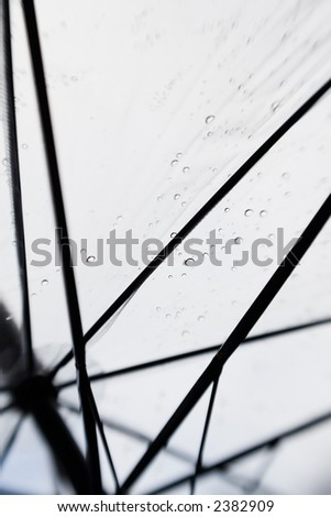 View from the inside of a see through umbrella on a rainy day. - stock photo