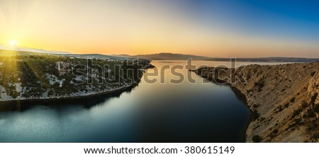 View from the Maslenica Bridge is a deck arch bridge carrying the D8 state road approximately 1 km to the west of the settlement of Maslenica, Croatia - stock photo