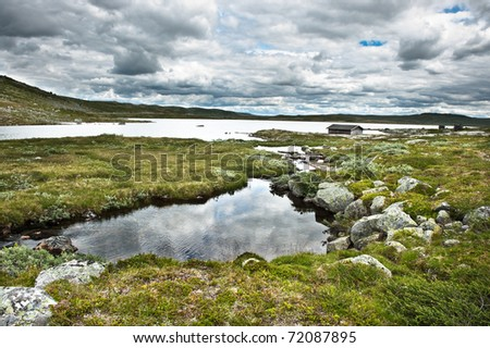 View from the mountain passage Hardangervidda between Bergen and Oslo city in Norway - stock photo