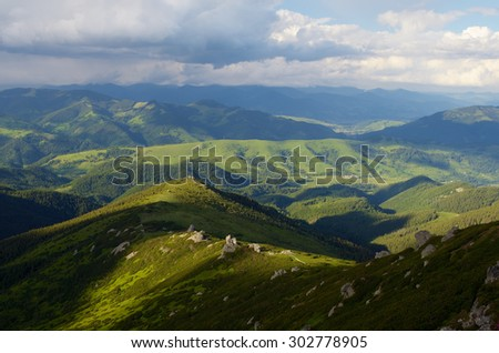 View from the mountain to the valley. Summer landscape. Carpathians, Ukraine. Europe - stock photo