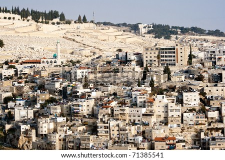 View from the old city walls on East-Jerusalem and a part of the Mount of Olives. Israel - stock photo