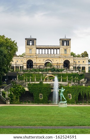 View from the park Sanssouci to the Orangery palace in Potsdam - stock photo