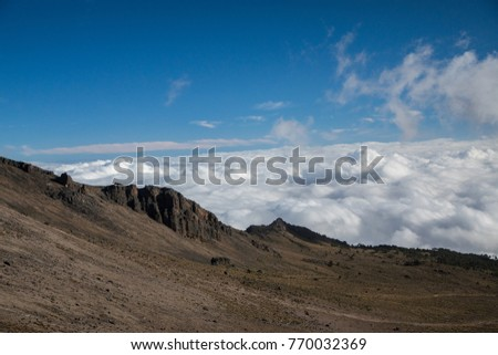view from the pico de orizaba above the clouds