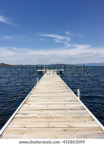 View from the pier on the sea at loneliness beach on Cunda Alibey island Balikesir Turkey - stock photo