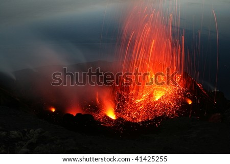 View from the Pizzo to the erupting crater area of volcano Stromboli in Italy - stock photo