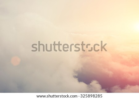 View from the plane of a beautiful fluffy big clouds with sunlight background with copy space for your text message or promotional content, advertising content - stock photo