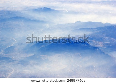 View from the plane over the Alps - stock photo