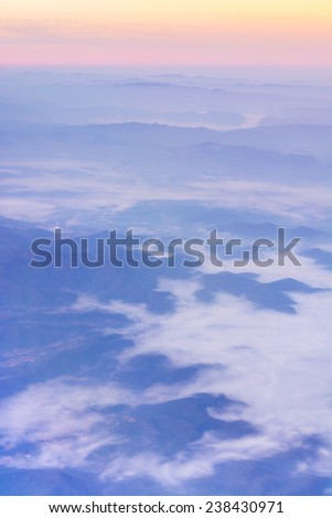 View from the plane window to see the mountain. - stock photo