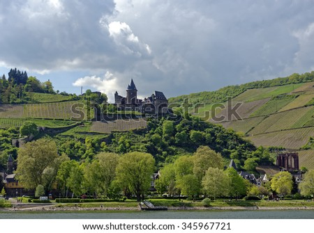 View from the River Rhine of Stahleck Castle and its surrounding vineyards at Bacharach in the famous Rhine Gorge north of Rudesheim, Germany