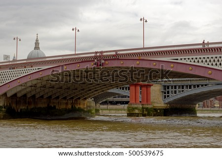 View from the River Thames of the ornate Blackfriars Bridge in London, England