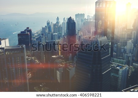 View from the roof of a modern city with tall office and commercial buildings at beautiful sunset. Developed business district with high skyscrapers with contemporary architecture in New York - stock photo