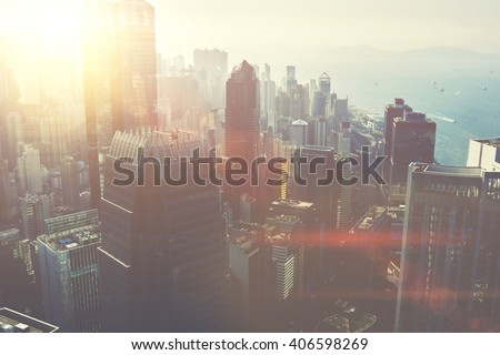 View from the roof on a modern business center in New York with office, commercial and residential buildings with contemporary architecture. Developed metropolitan city with tall skyscrapers near sea - stock photo