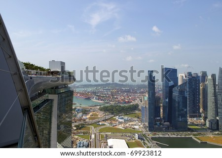 View from the roof top of new Marina Bay Sands hotel over shipyards and new business district, Singapore - stock photo