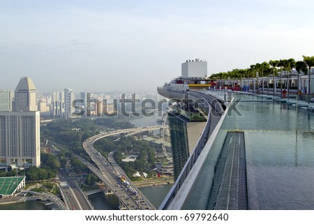 View from the roof top pool at new Marina Bay Sands hotel in early morning, Singapore - stock photo