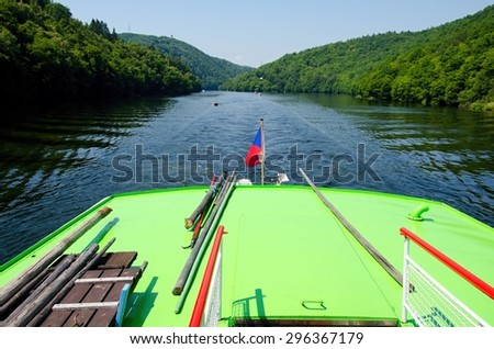 View from the stern of the boat cruising the Czech River. - stock photo