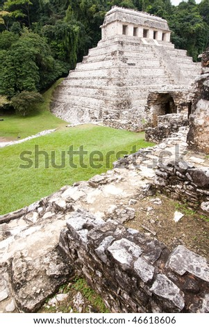 View from the 'The Palace' with the pyramid 'Temple of Inscriptions' in background in the ancient Mayan city of Palenque. Chiapas, Mexico. - stock photo