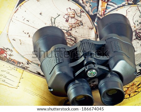 View from the top of binocular on antique map. - stock photo