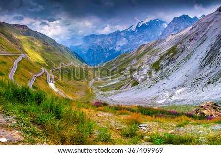 View from the top of famous Italian Stelvio High Alpine Road, elevation of 2,757 m above sea level. Stelvio Pass, South Tyrol,  province of Sondrio, Ortler Alps, Italy, Europe. - stock photo