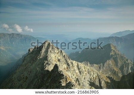 View from the top of Rysy (2499 m) on a smaller peak in the Polish Tatras.