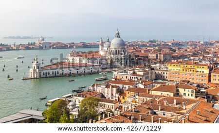 View from the top of San Marco bell tower of Venice and roman catholic church Santa Maria della Salute, Italy.  - stock photo