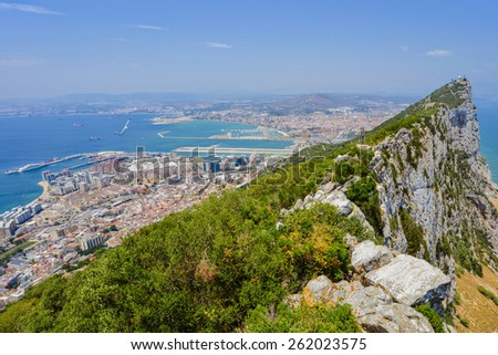 View from the top of the Rock towards La Linea de la Concepcion behind the famous Gibraltar airport runway/Rock of Gibraltar/Gibraltar, Europe - stock photo