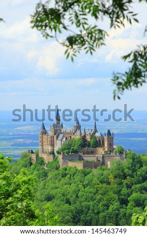 View from the top of Zeller Horn to Hohenzollern Castle in the Swabian Alb, Baden-Wuerttemberg, Germany - stock photo