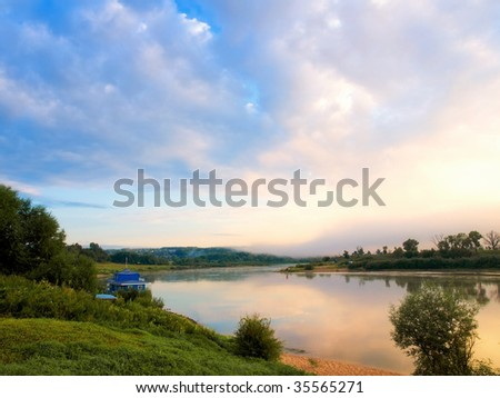 View from the top to the river on sunrise - stock photo