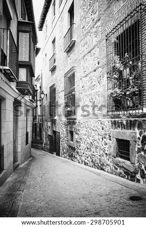 View from Toledo in Spain. UNESCO sightseeing, medieval architecture, houses. Black & white picture.