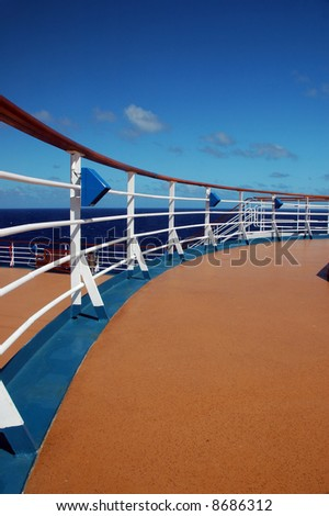 View from Top Decks of Cruise Ship of Ocean with Railing - stock photo