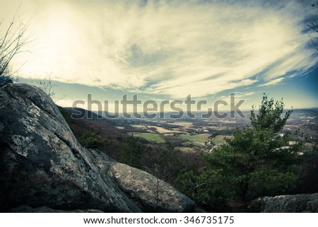 View from top of Appalachian Mountains with green pines and autumn maple and oak