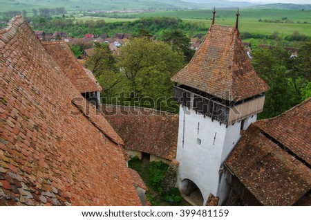 View from tower of Viscri fortified church (castle), Transylvania, Romania, UNESCO heritage - stock photo