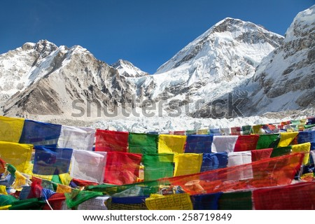 view from trek to Mount Everest base camp with rows of buddhist prayer flags - Khumbu valley - Sagarmatha national park - Nepal - stock photo