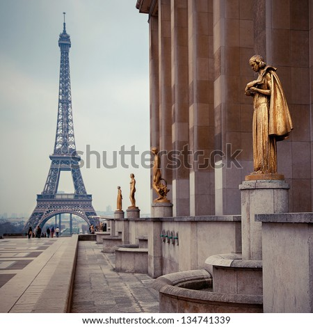 view from Trocadero with golden statues on Eiffel tower, Paris - stock photo