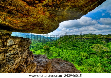 View from Umbrella Rock in the Yilo Krobo District, outside of Accra, Ghana. The Umbrella Rock is situated on a high land making it possible to watch nature hundreds of miles away into the green. - stock photo