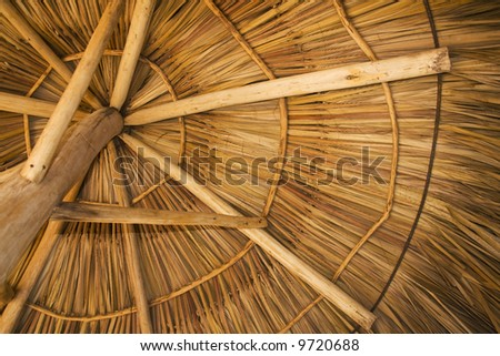 View from under a palapa, on a beach resort - stock photo