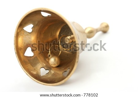 View from underneath a worn View from underneath a worn looking brass hand bell showing the clapper. - stock photo