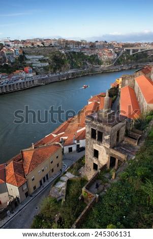 View from Vila Nova de Gaia over Douro river and city of Porto skyline in Portugal. - stock photo