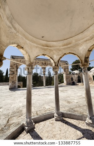 View from within a dome structure at one of the arched entrances surrounding the yard of Dome of the Rock, one of the holiest sites to Islam; on the Temple Mount in Jerusalem old city, Israel. - stock photo