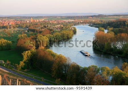 View in spring from the vineyards towards the town Volkach and the river Main in Bavaria, Germany. - stock photo