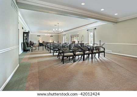 View inside funeral home with couches and chairs - stock photo