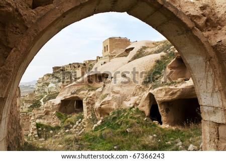 View inside the old abandoned hillside settlement of cavusin or chavushin near goreme in cappadocia, central turkey - stock photo