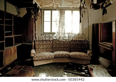 View into a burnt-out room with sofa - stock photo