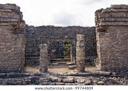 View into a Mayan ruin through the remains of it's access portal at Tulum, Quintana Roo, Mexico. - stock photo