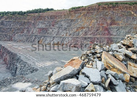 view into surface mine of porphyry rocks