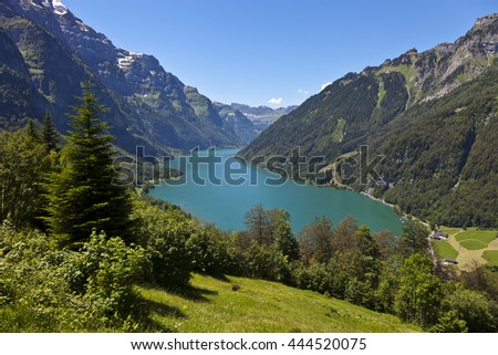 View into the Kloental valley with its lake on a beautiful summer day. The Kloental lies in the canton of Glarus in Switzerland.