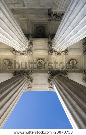 View looking up at the columns of the United States Supreme Court in Washington DC - stock photo