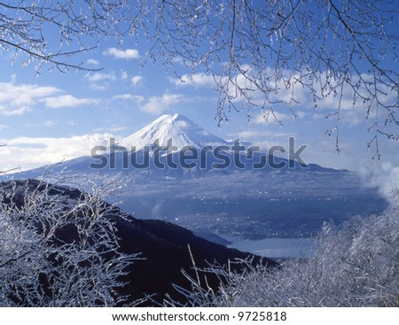 View Mt,Fuji from ice coating on the trees at mount peak - stock photo